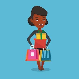 Gelukkige vrouwenholding het winkelen zakken en giftdozen.