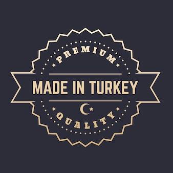 Gemaakt in turkije badge, stempel, vintage embleem in goud over donker, vectorillustratie