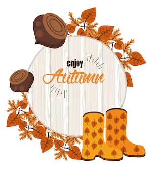 Geniet van herfstbelettering met noten en laarzen op houten achtergrond.