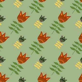 Geometrische bloem volkskunst naadloze patroon op groene achtergrond.