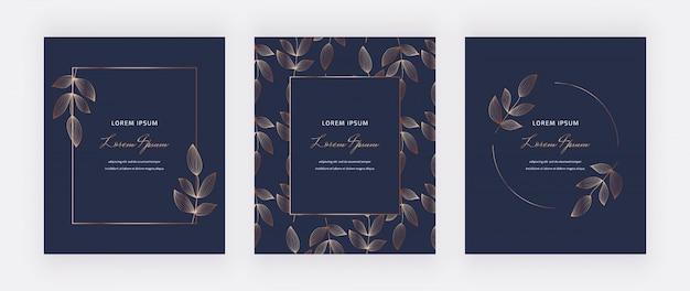 Geometrische marineblauwe kaarten met gouden bladeren, lijnen en kaders.