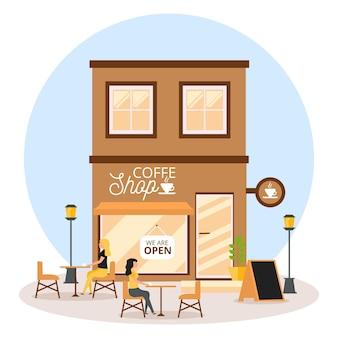 Geopend coffeeshop met een persoon aan tafel