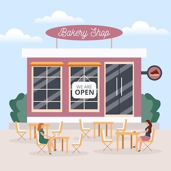 Geopende bakkerijwinkel met mensen die afstand houden
