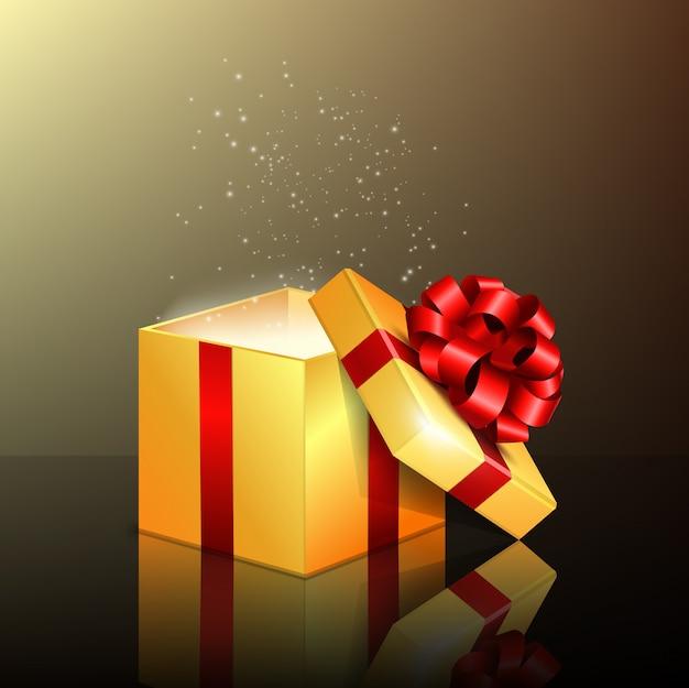 Geopende geschenkdoos met rood lint