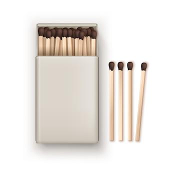 Geopende lege doos met bruine wedstrijden geïsoleerd, bovenaanzicht op wit