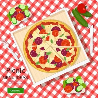 Geruite doek met pizza, sandwiches en groenten.