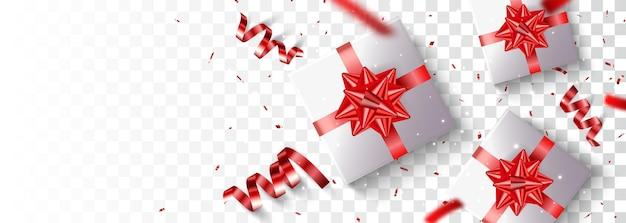 Geschenkdoos met gouden en rode confetti geïsoleerd