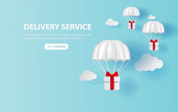 Geschenkdoos parachute drijvend op smartphone. app voor leveringsservice