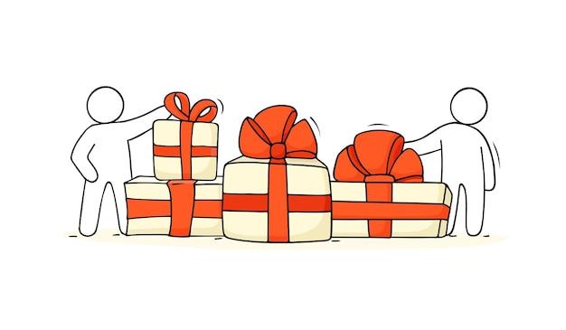Geschenkdozen met kleine mensen. hand getekende cartoon vectorillustratie voor kerst ontwerp.