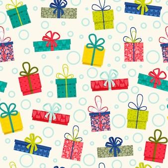 Geschenkdozen naadloos patroon. kleurrijke geschenkdozen met linten en strikken, op de lichte achtergrond voor geschenkdecoraties en vakantie-achtergronden.
