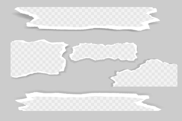 Gescheurde, gescheurde stukjes wit en grijs papier met zachte schaduw.