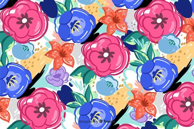 Geschilderde bloemenachtergrond met abstracte vormen