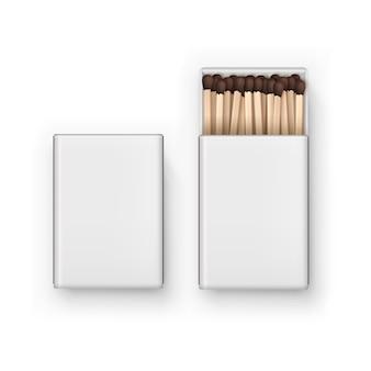 Gesloten geopende lege doos met bruine wedstrijden geïsoleerd, bovenaanzicht op wit