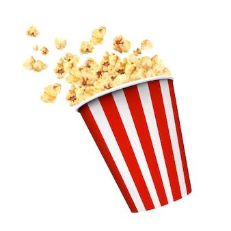 Gestreepte dooscontainer met heerlijke popcorn op witte achtergrond