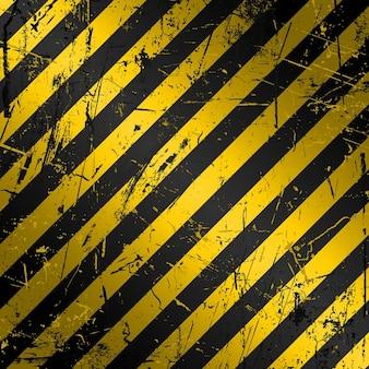 Getextureerde grunge bouw achtergrond in geel en zwart