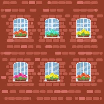 Gevel van een bakstenen huis onder het borduurwerk groot wit raam met bloemen in potten vector