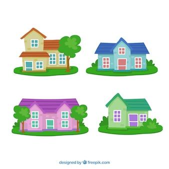 Gevels van huizen met tuinen pak