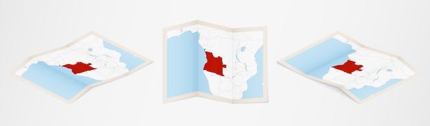 Gevouwen kaart van angola in drie verschillende uitvoeringen.