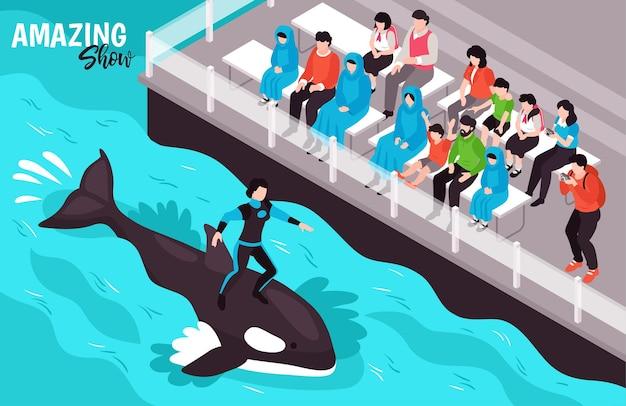 Geweldige show in isometrische compositie van het dolfinarium met vrouwelijke dierentrainer die op een zwemmende orka staat