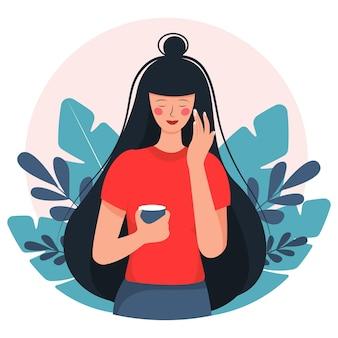 Gezichtsverzorging. mooie vrouw smeert crème op haar gezicht. in cartoon-stijl