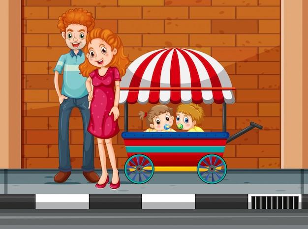 Gezin met kinderen in winkelwagen