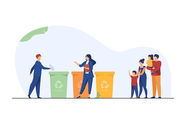 Gezin met kinderen kijken naar afval sorteren