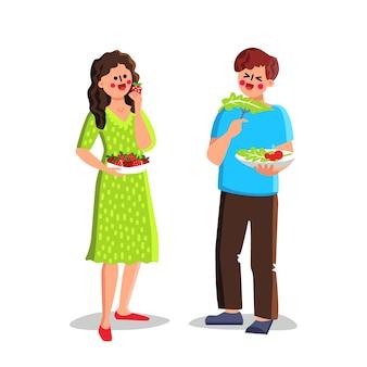 Gezond voedsel dat jongen en meisjespaar eet