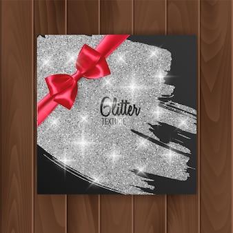Gift card cover met zilver glinsterende textuur en rode strik