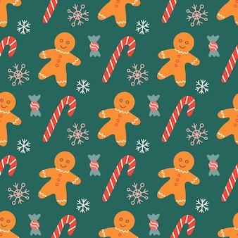 Gingerbread man met snoep en sneeuwvlokken op groene achtergrond, vector kerst naadloze patroon