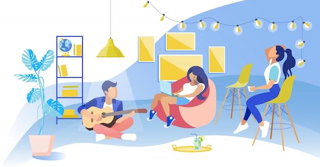 Girls in chair watch guy zit op floor play guitar