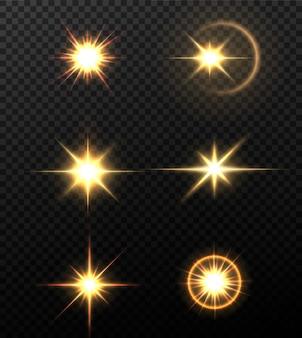 Glanzende gouden sterren geïsoleerd op zwarte achtergrond. effecten, lens flare, glans, explosie, gouden licht, set. stralende sterren, prachtige gouden stralen.