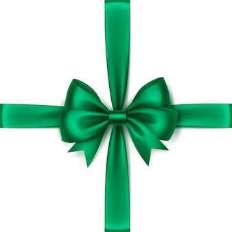 Glanzende groene smaragd satijnen strik en lint bovenaanzicht close-up geïsoleerd