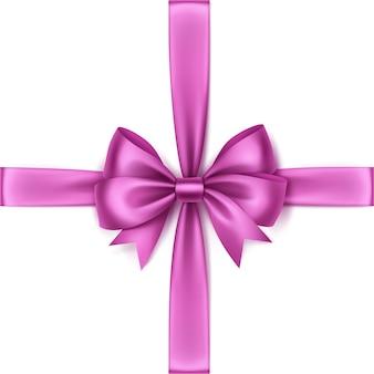 Glanzende licht roze satijnen strik en lint bovenaanzicht close-up geïsoleerd