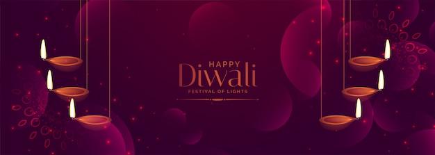 Glanzende paarse diwali festival banner met hangende diya