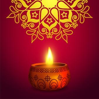 Glanzende rangoli-decoratie met olielamp voor diwali-viering