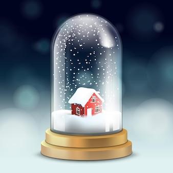 Glazen kristallen kolf, sneeuwbal met besneeuwd huis, vallende sneeuw,