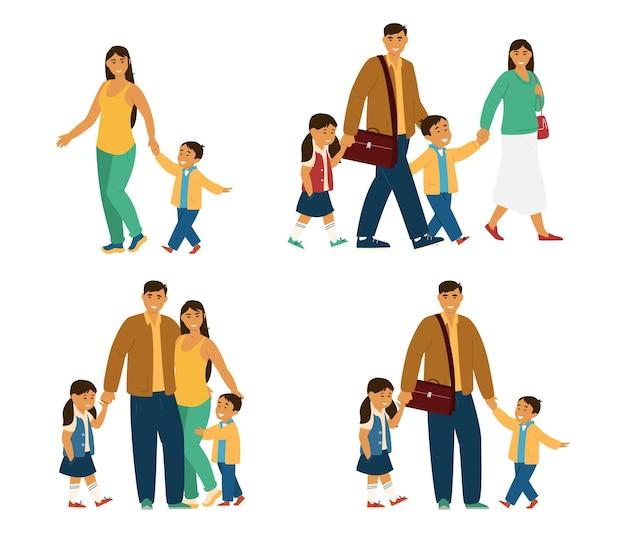 Glimlachend aziatisch gezin met kinderen jonge ouders met kinderen lopen knuffelend staand