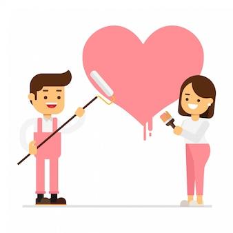 Glimlachend paar die groot hart op muur thuis schilderen