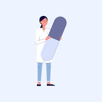 Glimlachende aantrekkelijke vrouwelijke apotheker of vrouw arts die gigantische pil, cartoon afbeelding op witte achtergrond houdt. gezondheidszorg en online apotheek.
