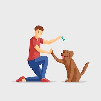 Glimlachende jongen met huisdieren vlakke illustratie. guy en viervoetige vriend spelen samen. positieve emoties, vriendschap, jonge man opleiding huisdier stripfiguur geïsoleerd op wit