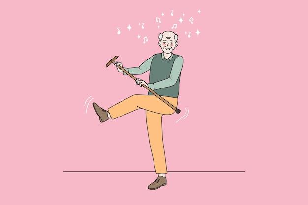 Glimlachende oudere man ontspannen dansen met wandelstok