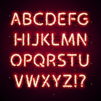 Gloeiend neon rood alfabet met glitter op donker