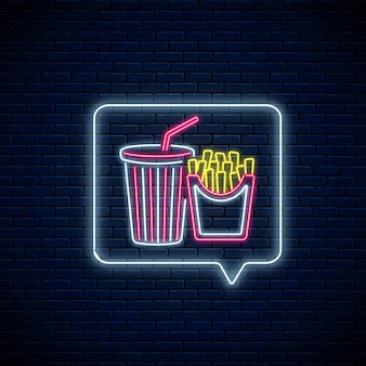 Gloeiend neonteken van frites en frisdrankbeker in berichtmeldingsframe op donkere bakstenen muurachtergrond. eten en drinken symbool in tekstballon in neon stijl. vector illustratie.