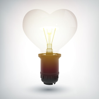 Gloeiende gloeilamp met plastic basisconcept in vorm van hart als geïsoleerd symbool van liefde
