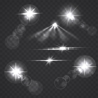 Gloeiende lichteffectsterren en flitsen op transparant