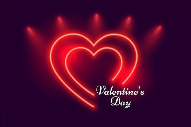 Gloeiende rode neon harten valentijnsdag wenskaart