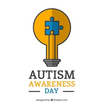 Gloeilamp met een stukje van de puzzel autisme dag achtergrond