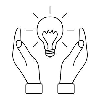 Gloeilamp met stralen tussen twee handen concept van ideeën inspiratie effectief denken