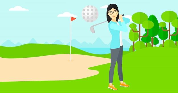 Golfspeler die de bal raakt.