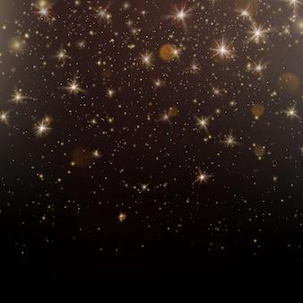 Goud glinsterende sterren stof sprankelende deeltjes op een donkere achtergrond. Premium Vector